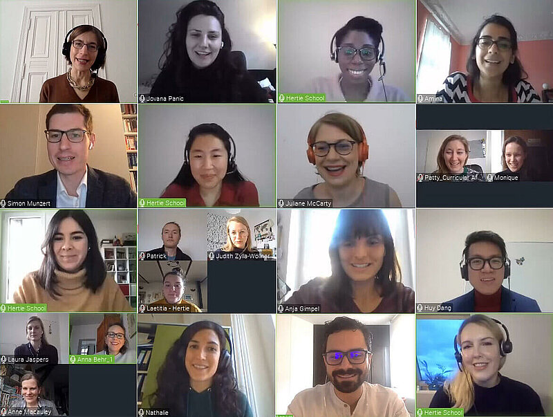 Video feeds of smiling faculty and staff members in a 4x4 grid