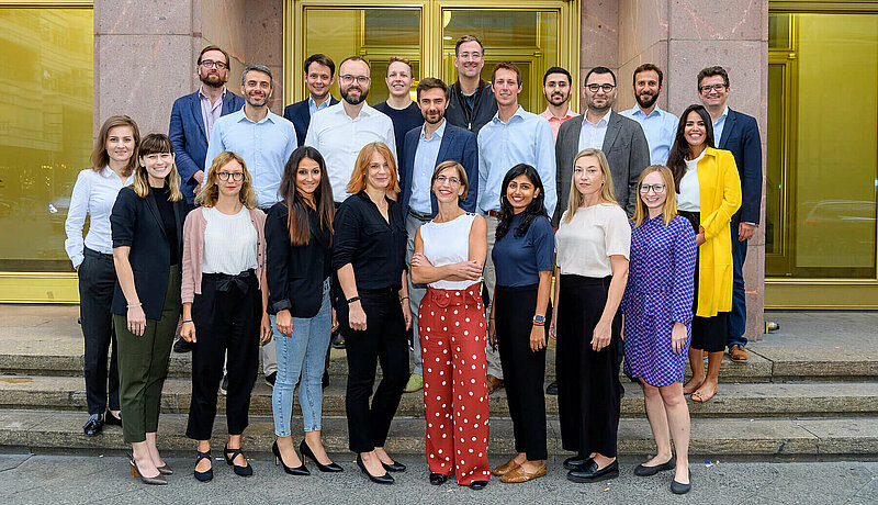 The Hertie School 2019 Executive MPA cohort in two rows on the steps in front of the Hertie School building. Dean Christine Reh and Programme Manager Juliane McCarty are in the front row, center.