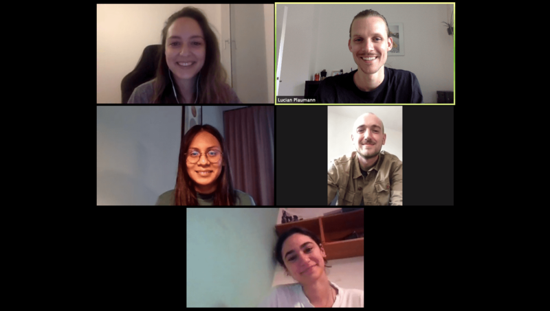 Five people smiling in a five-feed Zoom screenshot on a black background
