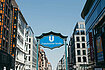 Blue Französische Straße U-Bahn station sign on Friedrichstraße, with the Galeries Lafayette on the right side and more office buildings on the left.